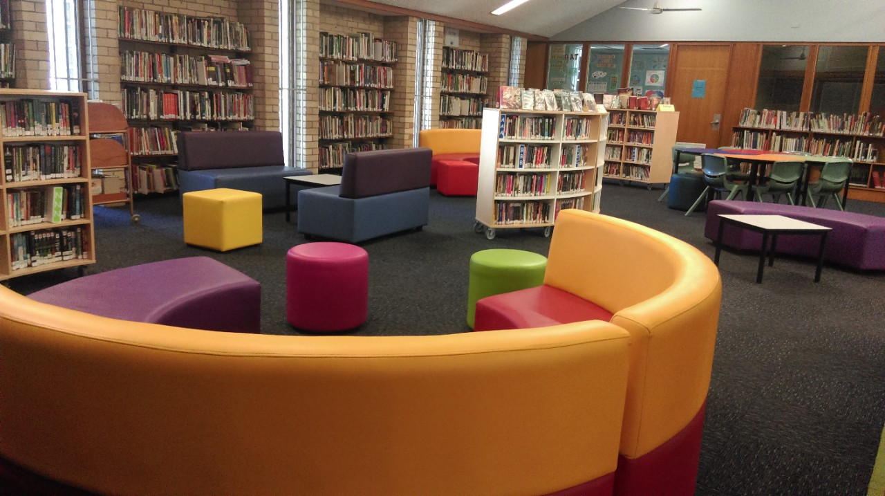The comfortable seating in our library has brightly coloured lounges.
